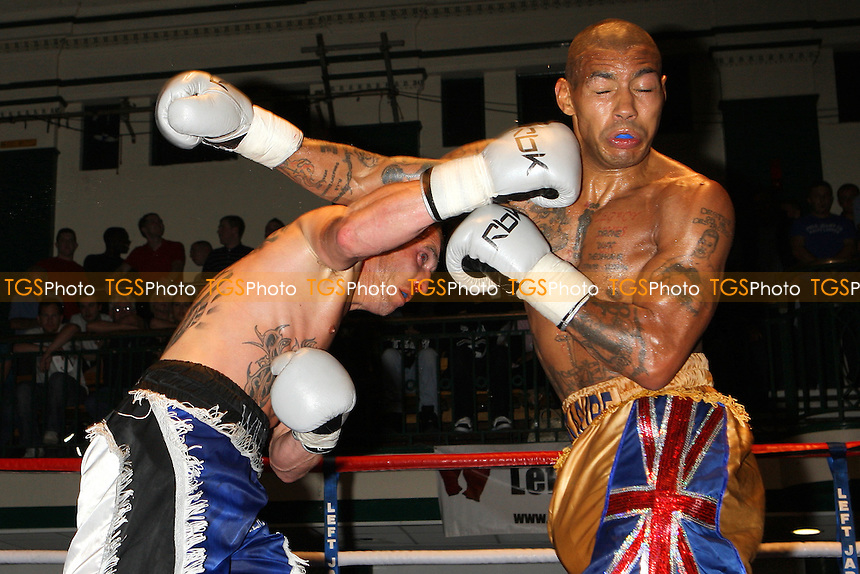 Ashley Theophane (gold/blue shorts) defeats Willie Thompson in a Welterweight boxing contest at York Hall, Bethnal Green, promoted by Left Jab - 10/10/10 - MANDATORY CREDIT: Gavin Ellis/TGSPHOTO - Self billing applies where appropriate - Tel: 0845 094 6026