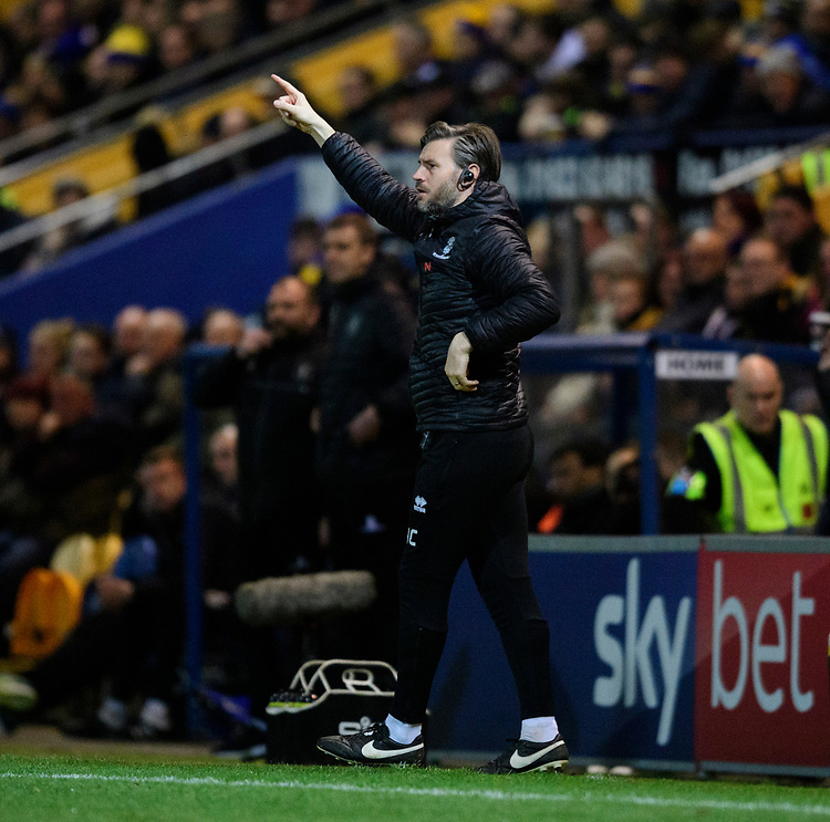 Lincoln City's assistant manager Nicky Cowley shouts instructions to his team from the technical area<br /> <br /> Photographer Chris Vaughan/CameraSport<br /> <br /> The EFL Sky Bet League Two - Mansfield Town v Lincoln City - Monday 18th March 2019 - Field Mill - Mansfield<br /> <br /> World Copyright © 2019 CameraSport. All rights reserved. 43 Linden Ave. Countesthorpe. Leicester. England. LE8 5PG - Tel: +44 (0) 116 277 4147 - admin@camerasport.com - www.camerasport.com