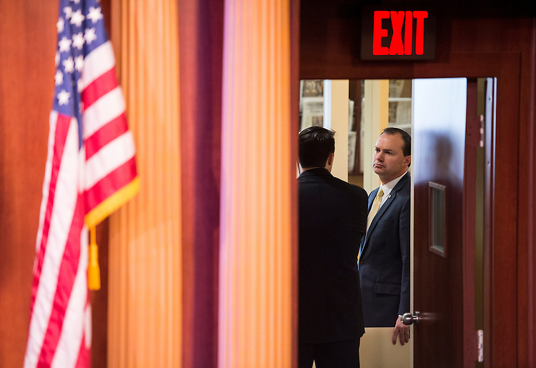 "UNITED STATES - JANUARY 21: Sen. Mike Lee, R-Utah, waits for Rep. Martha Roby, R-Ala., to arrive for their news conference in the Capitol to announce the introduction of the ""Working Families Flexibility Act,"" on Wednesday, Jan. 21, 2015. (Photo By Bill Clark/CQ Roll Call)"