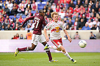 Dax McCarty (11) of the New York Red Bulls attempts to chase down a ball. The New York Red Bulls defeated the Colorado Rapids 4-1 during a Major League Soccer (MLS) match at Red Bull Arena in Harrison, NJ, on March 25, 2012.