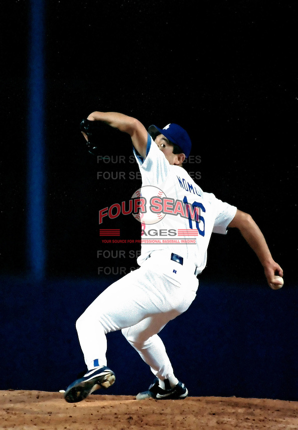 Hideo Nomo of the Los Angeles Dodgers during a 1995 season game at Dodger Stadium in Los Angeles,California.(Larry Goren/Four Seam Images)