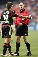 7 May 2005. DC United's Ben Olsen (14) talks with referee Kevin Stott while playing the Columbus Crew at RFK Stadium in Washington, DC.