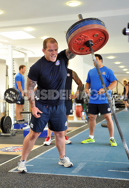 Paul James in the gym. Bath Rugby pre-season training on July 16, 2013 at Farleigh House in Bath, England. Photo by: Patrick Khachfe/Onside Images