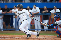 Logan Harvey (15) of the Wake Forest Demon Deacons follows through on his swing against the Florida Gators in Game Two of the Gainesville Super Regional of the 2017 College World Series at Alfred McKethan Stadium at Perry Field on June 11, 2017 in Gainesville, Florida.  (Brian Westerholt/Four Seam Images)