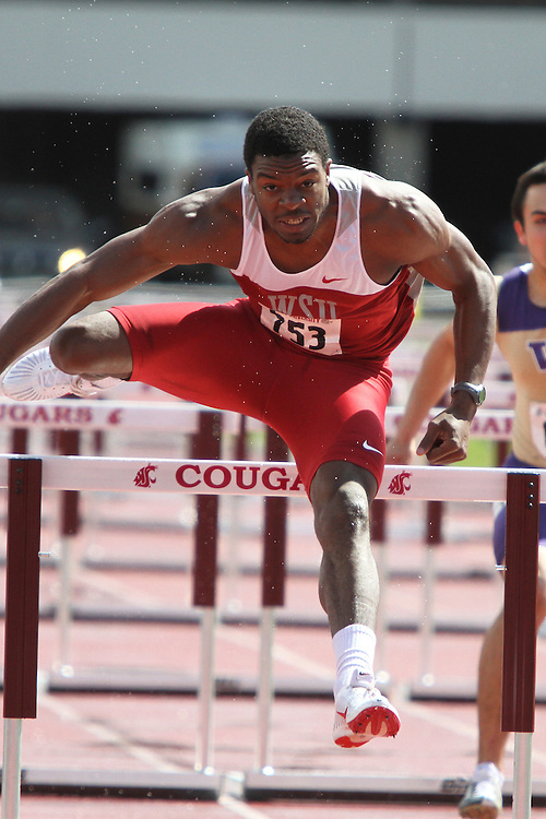 Jeshua Anderson, Washington State junior, clears the final hurdle while demolishing the field in the 110 meter hurdles final in the rainy and inclement weather during the Cougars dual track and field meet with arch-rival Washington at Mooberry Track at Washington State University in Pullman, Washington, on May 1, 2010.