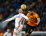 John Fleck of Sheffield Utd and Matt Doherty of Wolverhampton Wanderers  during the Premier League match at Molineux, Wolverhampton. Picture date: 1st December 2019. Picture credit should read: Simon Bellis/Sportimage