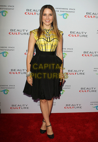SOPHIA BUSH .at The opening of Beauty Culture - a photographic exploration of how feminine beauty is defined, challenged and revered in modern society held at Annenberg Space for Photography in Century City, California, USA,.May 19th 11..full length dress black top skirt yellow bustier tartan checked plaid ankle strap shoes .CAP/ADM/KB.©Kevan Brooks/AdMedia/Capital Pictures.