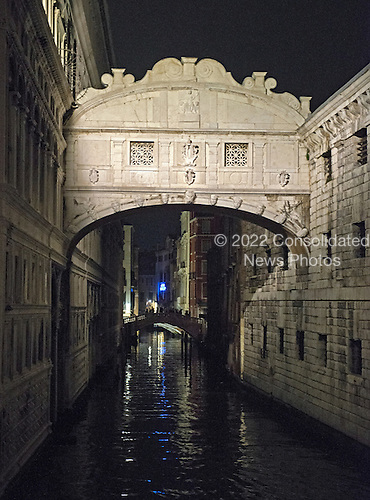 Nighttime view of the Bridge of Sighs, which was built in around 1600 to serve as a passageway between the Palazzo Ducale and the prison, in Venice, Italy on Sunday, October 27, 2013.  The bridge spans the Rio Del Palazzo, just a short distance from the Grand Canal. It earned its name from the sighs of prisoners being led to trial or to jail after their conviction.<br /> Credit: Ron Sachs / CNP