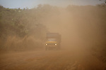 A truck drives in the red dust of the countryside where BP sugarcane fields and facility are located for producing ethanol, near the city of Itumbiara, in Goias state, Brazil,  on Tuesday, Oct 15, 2013. Since the US recently passed a number of regulations and standards for cars and dropped tariffs that were in place for decades against Brazilian sugar, Brazilian ethanol is now flowing to the U.S., and the ethanol industry in the country is consolidating and ramping up for a new era.