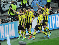 25.05.2013 London, England. Ilkay Gundogan celebrates with his team mates, Robert Lewandowski, Jakub Blaszczykowski and Kevin Grosskreutz after scoring a penalty in the 2013 UEFA Champions League Final between Bayern Munich and Borussia Dortmund from Wembley Stadium. Picture Credit: Tommy Grealy/actionshots.ie