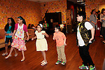 Leukemia & Lymphoma Society and Gilda's Club  New York City present Swing into Spring on April 18, 2015 at Gilda's Club in New York City, New York with decorating hats with Jane Elissa, exercizing and a magic show. (Photo by Sue Coflin/Max Photos)