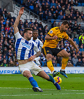 Brighton &amp; Hove Albion's Lewis Dunk (left) battles with Wolverhampton Wanderers' Jonny Otta (right) <br /> <br /> Photographer David Horton/CameraSport<br /> <br /> The Premier League - Brighton and Hove Albion v Wolverhampton Wanderers - Saturday 27th October 2018 - The Amex Stadium - Brighton<br /> <br /> World Copyright &copy; 2018 CameraSport. All rights reserved. 43 Linden Ave. Countesthorpe. Leicester. England. LE8 5PG - Tel: +44 (0) 116 277 4147 - admin@camerasport.com - www.camerasport.com