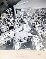BNPS.co.uk (01202 558833)<br /> Pic: PhilYeomans/BNPS<br /> <br /> Front line over Ortona in Eastern Italy<br /> <br /> Unearthed - fascinating unseen archive of cameras, photographs, documents and medals from a British aerial reconnaisance expert who fought all the way through Africa and southern Europe in WW2.<br /> <br /> Flt Lt Eric Cooper from London kept all his wartime paraphernalia, including his K20 handheld camera and stereoscopic plotting instruments until his death in Devon aged 96 in 2012.<br /> <br /> The incredible photographs show bombing raids, amphibious landings and badly damaged aircraft alongside off duty snaps of the campaign throughout the mediterraenean.<br /> <br /> His nephew is now selling the compelling collection at Plymouth Auction Rooms in Devon next week.