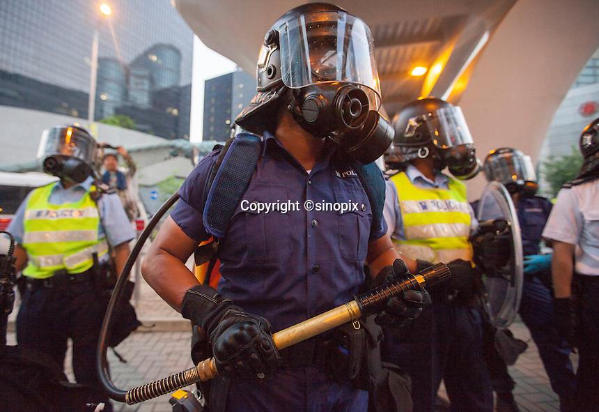 A Hong Kong policeman holds a pump action pepper sprayer as he prepares to use it om pro-democracy protesters during the first day of the mass civil disobedience campaign Occupy Central, Hong Kong, China, 28 September 2014.