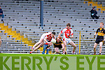 SNAP: Brendan O'Keeffe steps in as the two Johnny Buckley's challenge for the loose ball during the O'Donoghue Cup final in Fitzgerald Stadium on Sunday