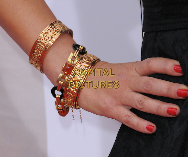 "LEAH REMINI .at the CBS Films' L.A. Premiere of ""The Back-Up Plan"" held at The Village Theatre in Westwood, California, USA, April 21st, 2010..arrivals detail red nails nail varnish hand gold bracelets .CAP/RKE/DVS.©DVS/RockinExposures/Capital Pictures."