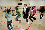 Salvation Army Maj. Ruth Fay, center, jumps rope with children, from left, Ta-Leah Johnson, 9, Lamecia Merchant, 11, Morgan Hyde, 9, Derika Young, 11, and Atianna Merchant, 10, (back to camera) during an after-school program on May 19, 2009.  Major Fay and her husband Maj. Bob Fay leave on July 1st to take a new post in St. Louis.
