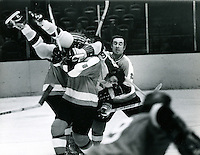 Seals Dick Matiussi on top of Flyers, #5 Brent Hughes #2 is Ed Van Impe. (PHOTO 1971 by Ron Riesterer)