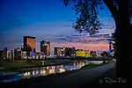 Dayton Ohio skyline, dusk with river, tree.