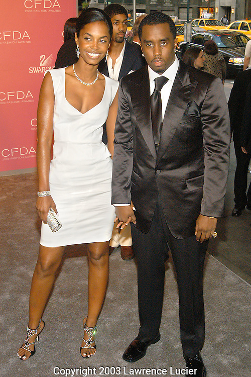 Kim Porter and Sean Combs (R)