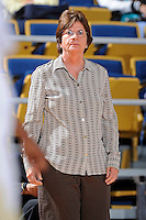 11 November 2011:  FIU Women's Basketball Head Coach Cindy Russo keeps an eye on her players during the first half as the FIU Golden Panthers defeated the Jacksonville University Dolphins, 63-37, at the U.S. Century Bank Arena in Miami, Florida.