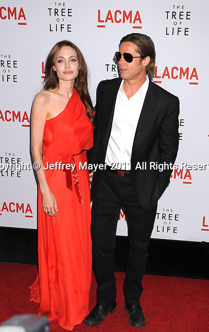 "LOS ANGELES, CA - MAY 24: Angelina Jolie and Brad Pitt attend ""The Tree Of Life"" Los Angeles Premiere at the Bing Theatre in the Los Angeles County Museum of Art on May 24, 2011 in Los Angeles, California."