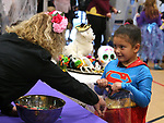 Mia Castaneda, 7, trick-or-treats at the Carson City Boo-nanza at the Community Center on Wednesday, Oct. 25, 2017. Co-hosted by Carson City Parks and Recreation, the Carson City Library and the Carson City Aquatics Facility, hundreds of families participate in the event which includes trick-or-treating, a haunted house, games, crafts, a dive-in movie and more.<br /> Photo by Cathleen Allison/Nevada Momentum