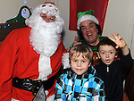 Micheal Reid and Sam Dolan pictured with Santa and Bubbles when he came to St Mary's GAA club in Ardee. Photo: Colin Bell/pressphotos.ie