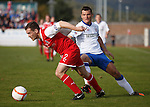 David McClune takes the ball away from Lee McCulloch