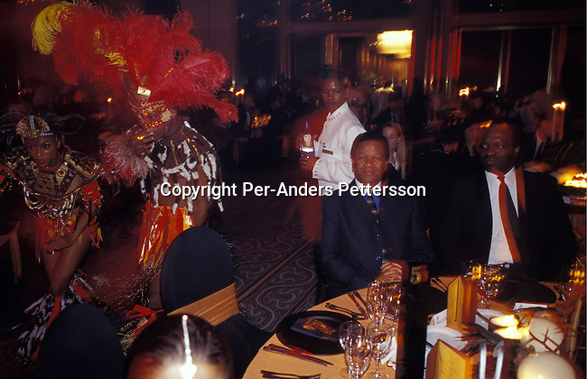 JOHANNESBURG, SOUTH AFRICA -  NOVEMBER 28: Jeff Radebe (center), the minister for public enterprises, attends a black empowerment gala on November 28, 2003 in Sandton, a suburb in Johannesburg, South Africa. The gala, a yearly event, awarded prizes to the best suppliers of the year. Telkom, the state controlled telephone company was partially privatized in March 2003 and listed on the New York and Johannesburg stock exchanges. A number of shares were subsidized to former disadvantaged black South Africans. .Photo: Per-Anders Pettersson/iAfrika Photos...