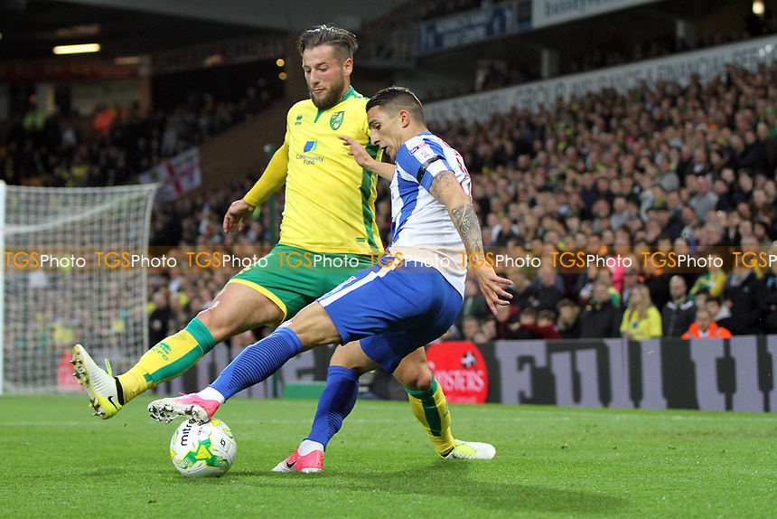 Mitchell Dijks of Norwich City tries to block Anthony Knockaert of Brighton and Hove Albion during Norwich City vs Brighton & Hove Albion, Sky Bet EFL Championship Football at Carrow Road on 21st April 2017