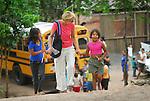 Village near Tegucigalpa, Honduras. Volunteer western mission woman with children