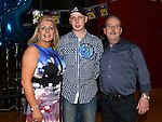 Darragh Maguire celebrating his 21st birthday in the Thatch with parents Paul and Ann. Photo:Colin Bell/pressphotos.ie