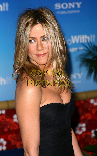 JENNIFER ANISTON.Attending the premiere of 'Just Go With It' at the Ziegfeld Theatre in New York City, New York, NY, USA, 8th February 2011..portrait headshot  strapless black  bustier tanned cleavage .CAP/ADM/PZ.©Paul Zimmerman/AdMedia/Capital Pictures.