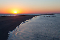 Sunrise at Raccoon Island, a barrier island off the Louisana coast. This island is a critical location for nesting and migratoy birds and is rapdily eroding due to a lack of sediment caused by the channelization of the Mississippi River. Isles Dernieres, Terrebonne Parish, Louisiana. October.