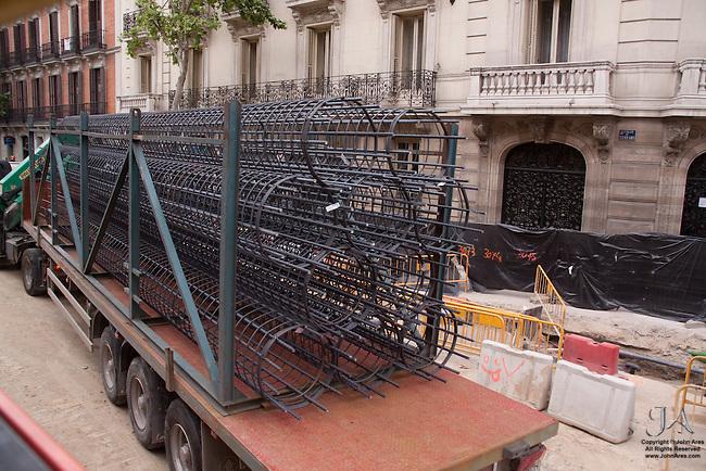 Truck delivering load of Rebar at construction site