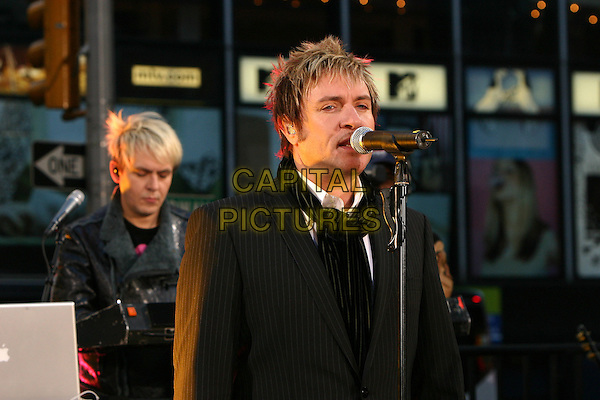 DURAN DURAN.NICK RHODES & SIMON LE BON.Perform on ABC's Good Morning America Concert Series in New York City, USA, October 12 th 2004..half length live gig music on stage scarf.Ref: IW.www.capitalpictures.com.sales@capitalpictures.com.©Ian Wilson/Capital Pictures .