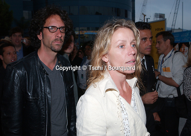 Frances McDormand and husband Joel Coen arriving at The IFP/West Los Angeles Film Festival premiere of Lovely & Amazing at the Arclight Cinerama dome in Los Angeles. June 20, 2002.           -            McDormandFrances_CoenJoel03.jpg