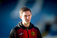 8th February 2020; Dens Park, Dundee, Scotland; Scottish Championship Football, Dundee versus Partick Thistle; Steven Saunders of Partick Thistle inspects the pitch before the match