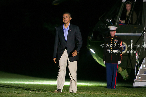 United States President Barack Obama walks across the south lawn of The White House after returning from a trip to New Orleans and Miami on November 9, 2013 in Washington, DC. <br /> Credit: Kristoffer Tripplaar  / Pool via CNP