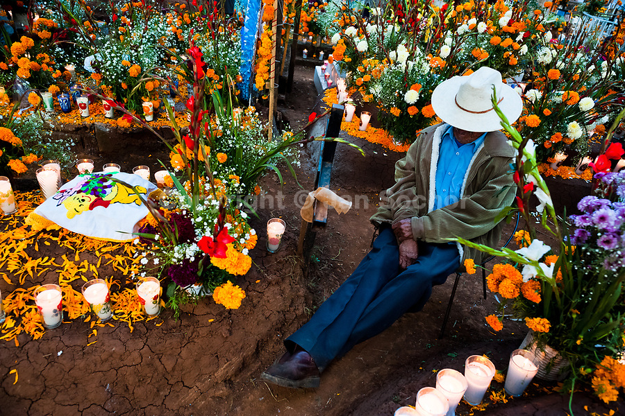 A Mexican man sits at the flower-decorated gravesite to honor his deceased relatives during the Day of the Dead celebration in Tzintzuntzan, Michoacán, Mexico, 2 November 2014. Day of the Dead ('Día de Muertos') is a syncretic religious holiday, celebrated throughout Mexico, combining the death veneration rituals of the ancient Aztec culture with the Catholic practice. Based on the belief that the souls of the departed may come back to this world on that day, people gather on the gravesites praying, drinking and playing music, to joyfully remember friends or family members who have died and to support their souls on the spiritual journey.