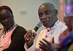 """The Rev. Canon Gideon Byamugisha, a founder of the International Network of Religious Leaders Living with or Personally Affected by HIV or AIDS (INERELA+), speaks during a panel discussion at the July 21 opening session of """"Faith Building Bridges"""" in Amsterdam, the Netherlands. The July 21-22 interfaith event, sponsored by the World Council of Churches-Ecumenical Advocacy Alliance, was held on the eve of the 2018 International AIDS Conference."""