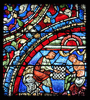 The younger son (on the right) is tempted into a game of dice on a chess-like board, and gambles away his clothes, from the Parable of the Prodigal Son stained glass window, in the north transept of Chartres Cathedral, Eure-et-Loir, France. This window follows the parable as told by St Luke in his gospel. It is thought to have been donated by courtesans, who feature in 11 of the 30 sections. Chartres cathedral was built 1194-1250 and is a fine example of Gothic architecture. Most of its windows date from 1205-40 although a few earlier 12th century examples are also intact. It was declared a UNESCO World Heritage Site in 1979. Picture by Manuel Cohen