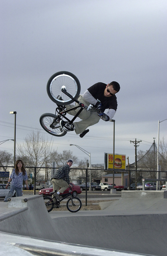 A BMX rider boosts an invert out of a quarterpipe at Los Altos skatepark in Albuquerque, NM in 2002.