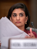 "Seema Verma, Administrator, Centers for Medicare & Medicaid Services, US Department of Health and Human Services, shuffles some papers as she testifies before the United States Senate Committee on Homeland Security & Governmental Affairs during a hearing entitled ""Examining CMS's Efforts to Fight Medicaid Fraud and Overpayments"" on Capitol Hill in Washington, DC on Tuesday, August 21, 2018.<br /> Credit: Ron Sachs / CNP"