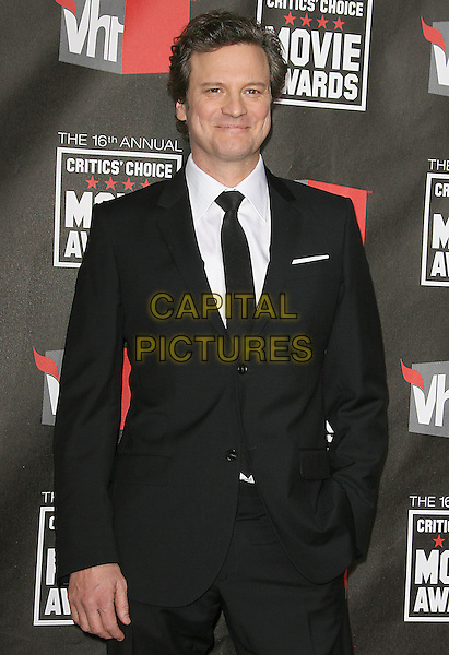 COLIN FIRTH .at The16th Annual Critics' Choice Movie Awards held at The Hollywood Palladium in Hollywood, California, USA, January 14th, 2011..half length black white shirt suit tie hand in pocket .CAP/RKE/DVS.©DVS/RockinExposures/Capital Pictures.