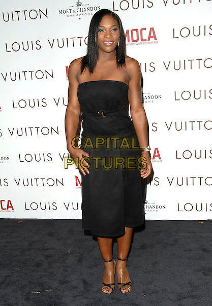SERENA WILLIAM.at The Louis Vuitton Gala Celebrating Murakami Exhibition held at  The Geffen Contemporary at MOCA in Los Angeles, California, USA, October 28 2007.                                           full length Strapless dress black hand on hip.CAP/DVS.©Debbie VanStory/Capital Pictures