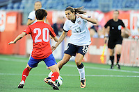 US Women's National midfielder Tobin Heath (17) works the ball against Korea Republic defender Kim Hyeri (20) during the International Friendly soccer match between the USA Women's National team and the Korea Republic Women's Team held at Gillette Stadium in Foxborough Massachusetts.   Eric Canha/CSM