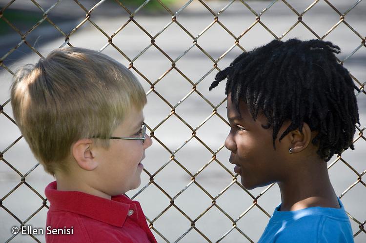 MR / Schenectady, NY. Elmer Avenue School (urban public elementary school). 3rd Grade. Two students look at each other and smile. Boy left: 8; Boy right: 8, African American. MR: Sze4, Dav10. ID: AH-FRD. © Ellen Senisi