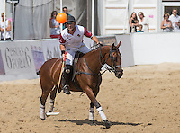 Tarquin Southwell of England keeps his eyes on the ball during the Wales v England match at the Asahi Beach Polo Championship  at Sandbanks, Poole, England on 10 July 2015. Photo by Andy Rowland.